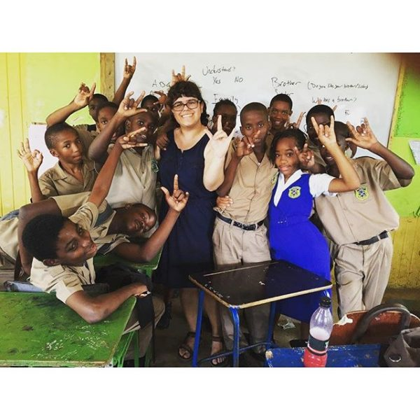 Diana Foronda '17 poses with students she worked with during the spring break Jamaica Cultural Immersion Program. #myhollins #signlanguage
