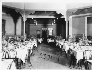 1890 - Fig. 51 Dining Hall Christmas dinner decorations