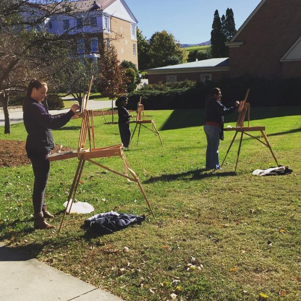 Students painting outside