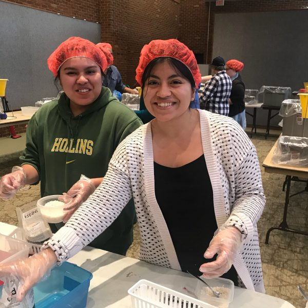 Photo of Hollins students helping package meals for Rise Against Hunger