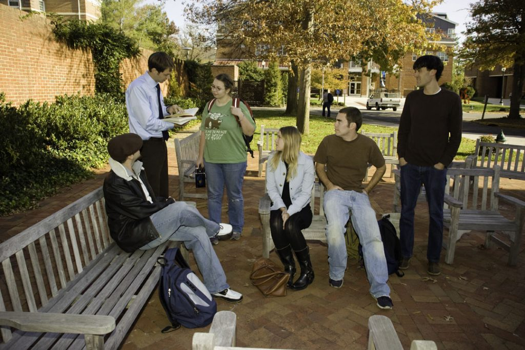 Photo of grad students talking