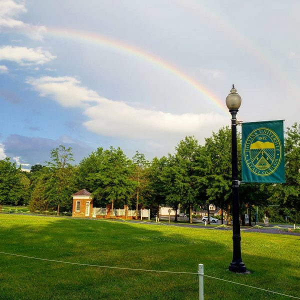Photo of double rainbow over campus