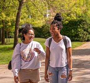 Photo of two students walking