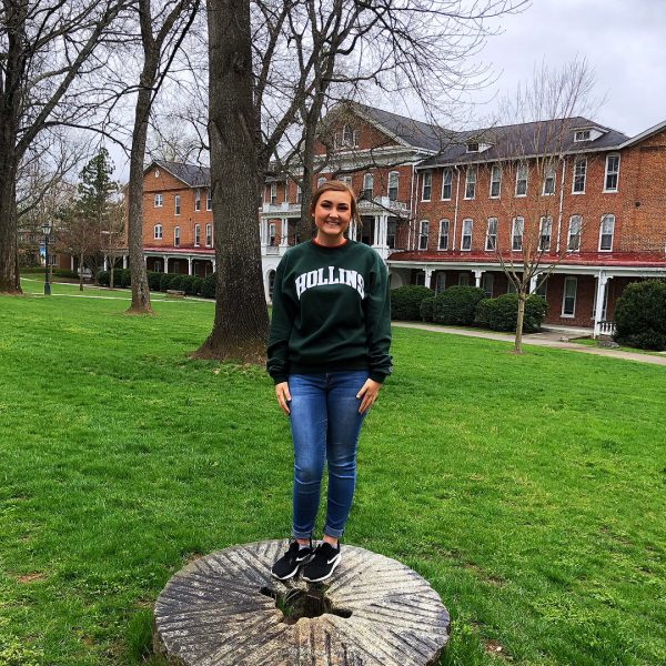 Photo of student standing on millstone