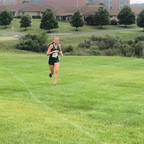 Photo of student running cross country