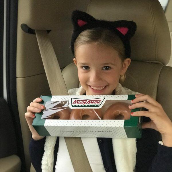 Photo of little girl holding doughnuts