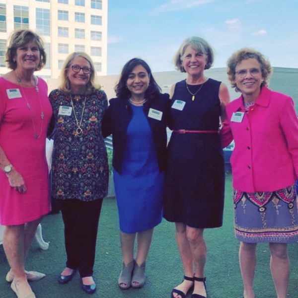 Photo of alumnae on rooftop in Norfolk