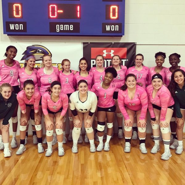 Photo of volleyball team wearing pink