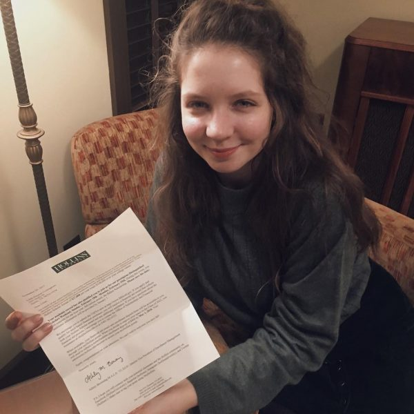 Photo of student with acceptance letter