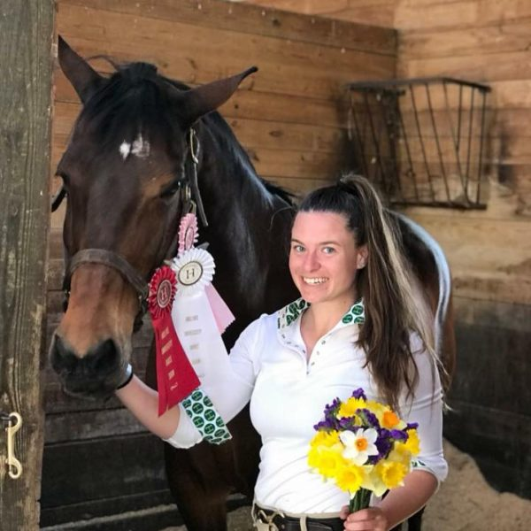 Photo of student with horse and medals