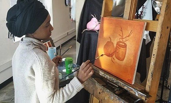 Photo of student painting in studio
