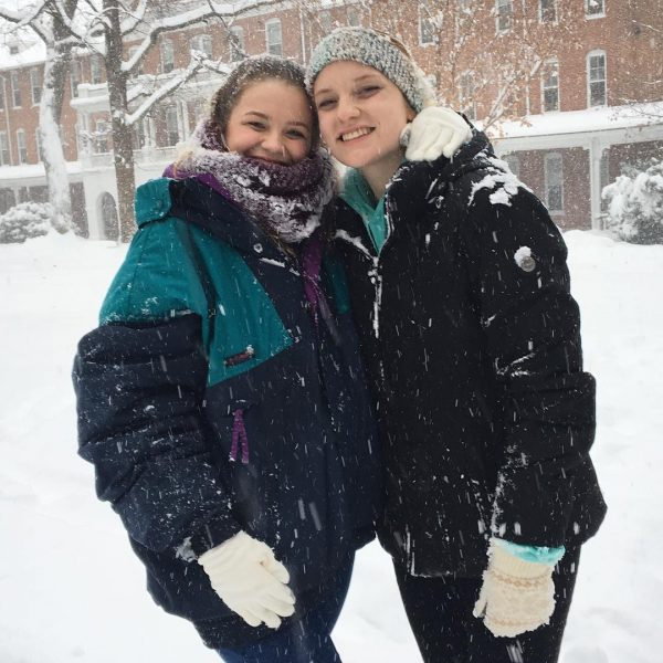 Photo of two students in the snow