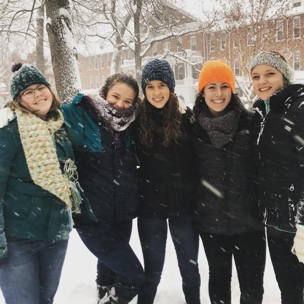 Photo of students on Front Quad during the snow
