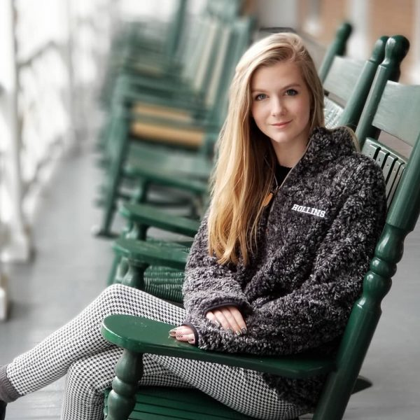 Photo of student sitting in rocking chair