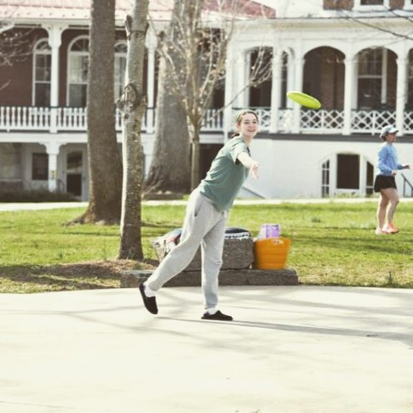 Photo of student with frisbee on FrontQuad