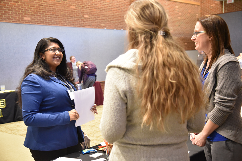 Photo of student and employers at HireHollins