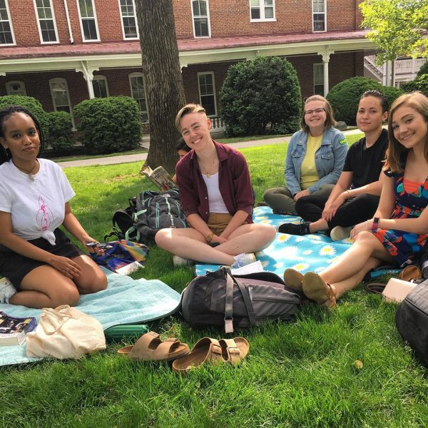 Photo of Hollins students sitting on blanket on Front Quad
