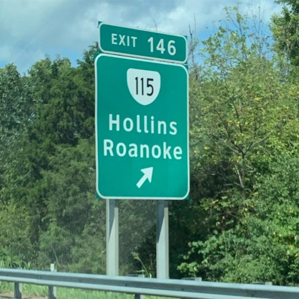 Road sign for Hollins